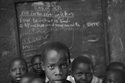 Children in Front of Chalkboard,  Magada, 2006